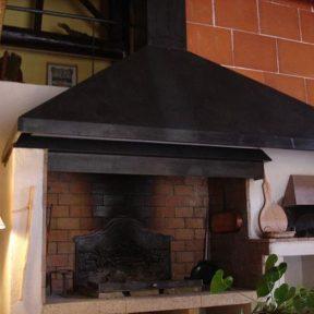 Hôte cheminée ferronnier
